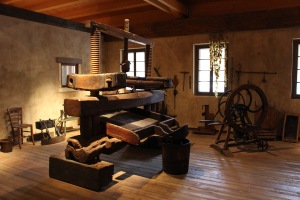 the grape press has progressed somewhat in the last 100 years of winemaking