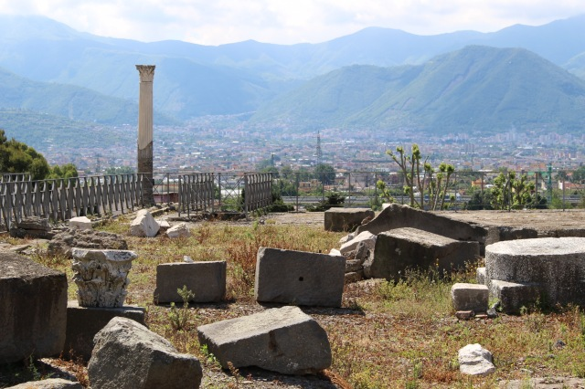 spectacular scenery provides an idyllic backdrop to the scene of ruin and devastation, what remains of Pompeii