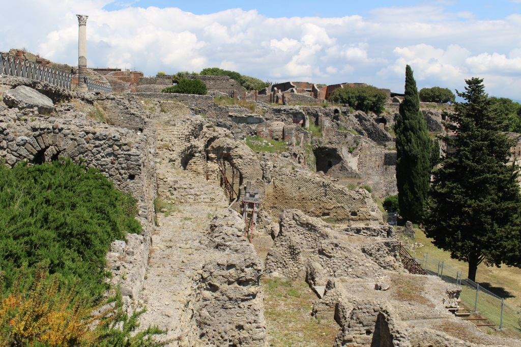Pompeii was built on a natural plateau of tufa rock, deposited by Vesuvius over thousands of years. Ironic considering the city's inevitable fate, and the modern city's future...