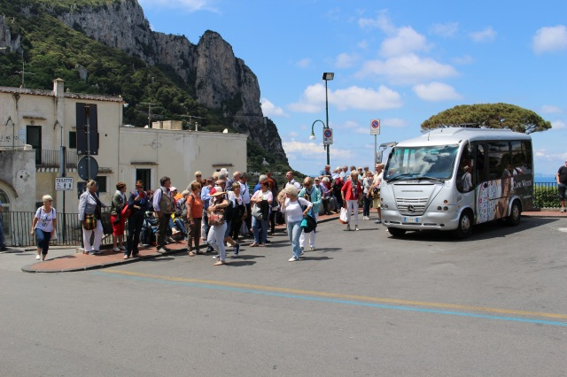 An elderhostel tour group waits for a bus back to the harbor from Capri town center.