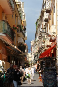 the narrow streets of Sorrento are lined with shopping options, filled with holiday apartment rentals above