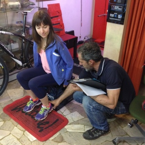 Davide works with his newest customer fitting the perfect bike saddle.