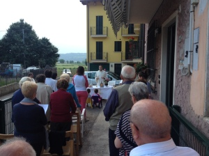 the community gathers for an outdoor mass