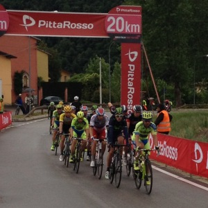 a group of riders well behind the peloton make it through the 20km marker