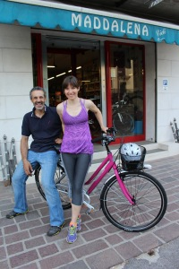 Davide, creator of customs bikes, and owner of Cicli Maddalena, poses with Alicia and her shiny new bike!