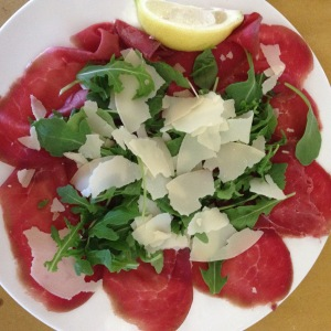 bresaola with rucola and fresh grana, dressed with fresh squeezed lemon juice