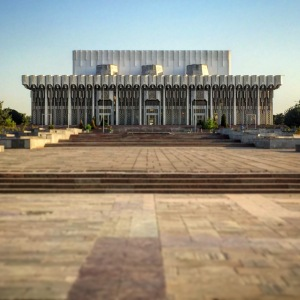 The imposing monumental concrete facade of the Palace of People's Friendship greets you upon emerging from the Bunyodkor metro