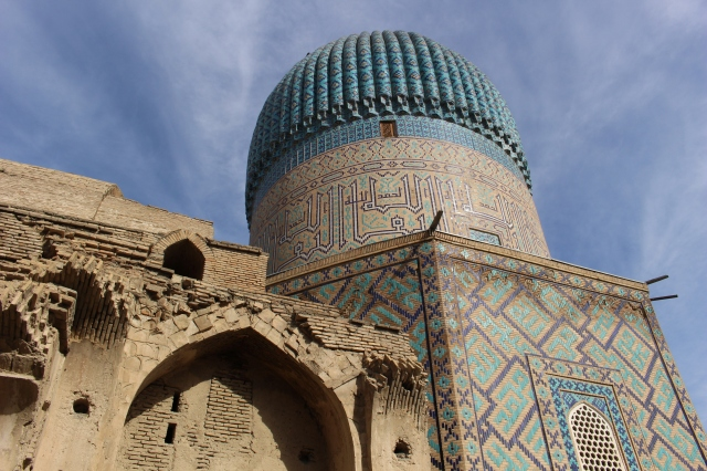 the unfinished madrassa was left alone while the impressive mausoleum was constructed alongside