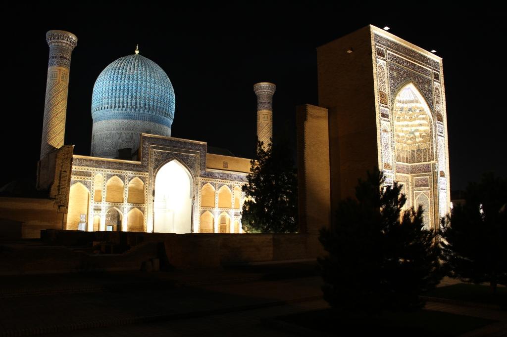 exterior of the impressive Gur-Emir complex illuminated at night