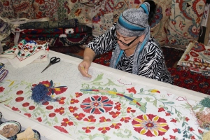 traditional embroidery demonstration within the walls of the Ulugbek Madrasah