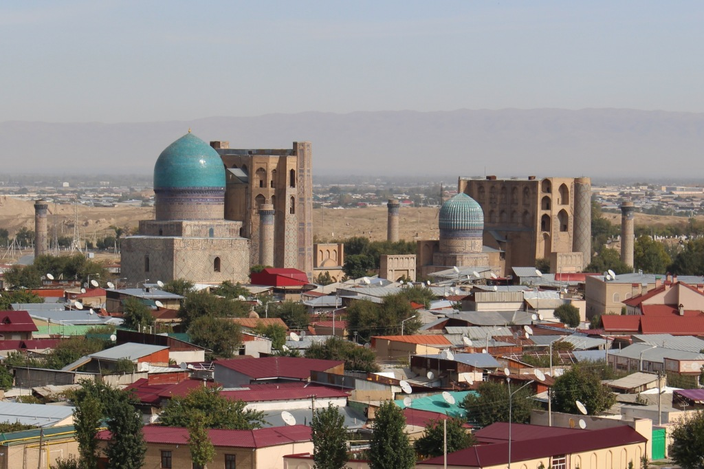 It's magnificence best appreciated from afar, the Bibi-Khanym rises above an old-town mahalla of Samarkand - Viewed from viewed from a minaret of the Ulugbek Madrasah at the Registan complex